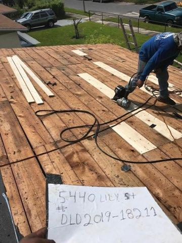 Orlando, FL - We will make sure your roof is up to code . Here we are repairing damaged decking . Ask for Jeff B for all your roofing needs
