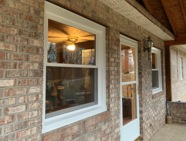 Martinsville, IN - Furnished and installed 8 White double hung windows and 1 White 3-lite sliding window. We wrapped the exterior of the windows and 1 patio door in White no-mar coated aluminum.