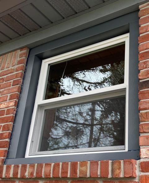 Window Man furnished and installed a White double hung window. We wrapped the exterior of the window in Midnight Blue no-mar coated aluminum.