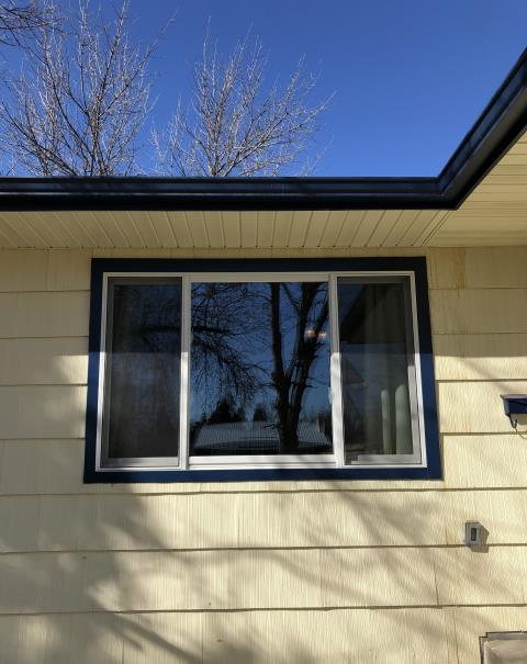 Great Falls, MT - Replaced 3 windows in Great Falls, MT, with new Renewal by Andersen windows - we were able to wrap these windows with a maintenance free blue metal for a perfect match to existing trim!