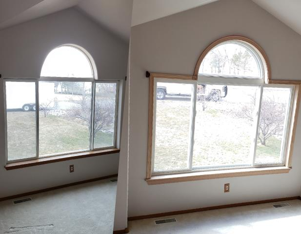 Worden, MT - This Home in Worden got an upgraded living room window including a custom half circle cap mulled unit with new oak interior trim work!