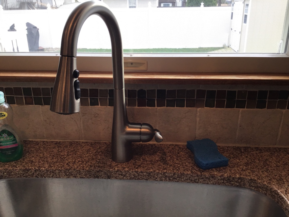 Supplied and installed one new Moen Arbor kitchen pull down kitchen faucet