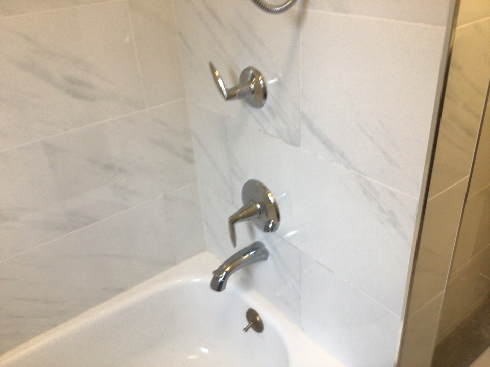 Installed customer supplied Kohler shower trim and Kohler hand held