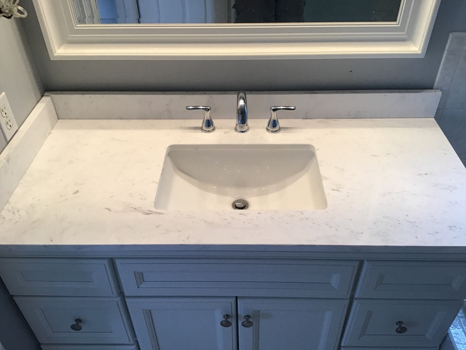 Customer supplied vanity and lav faucet installed.