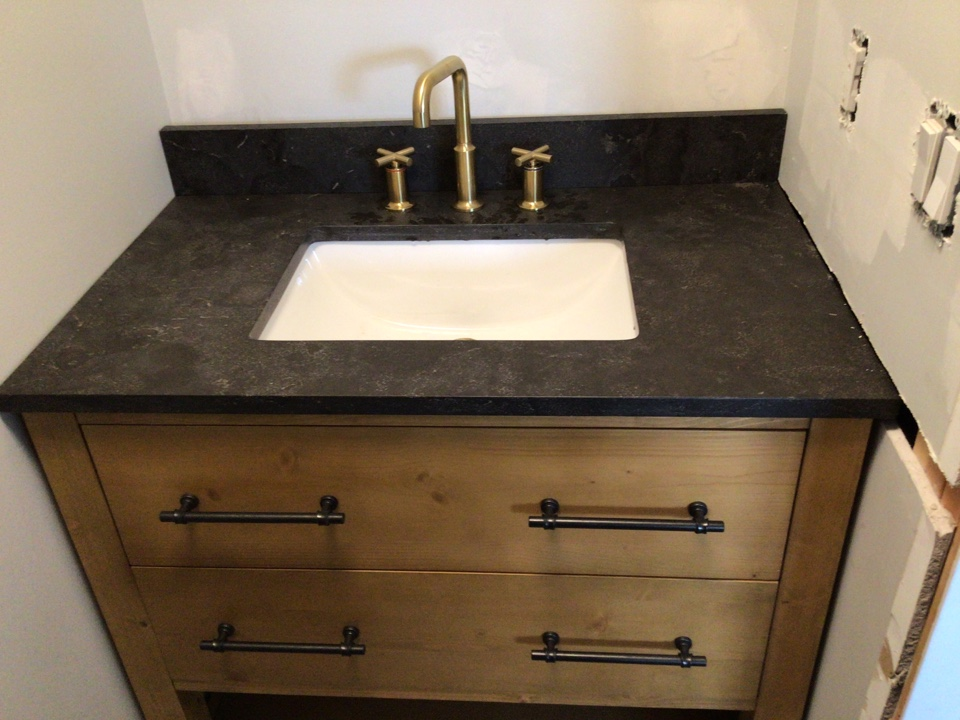 Installed customer supplied vanity and faucet in Manasquan