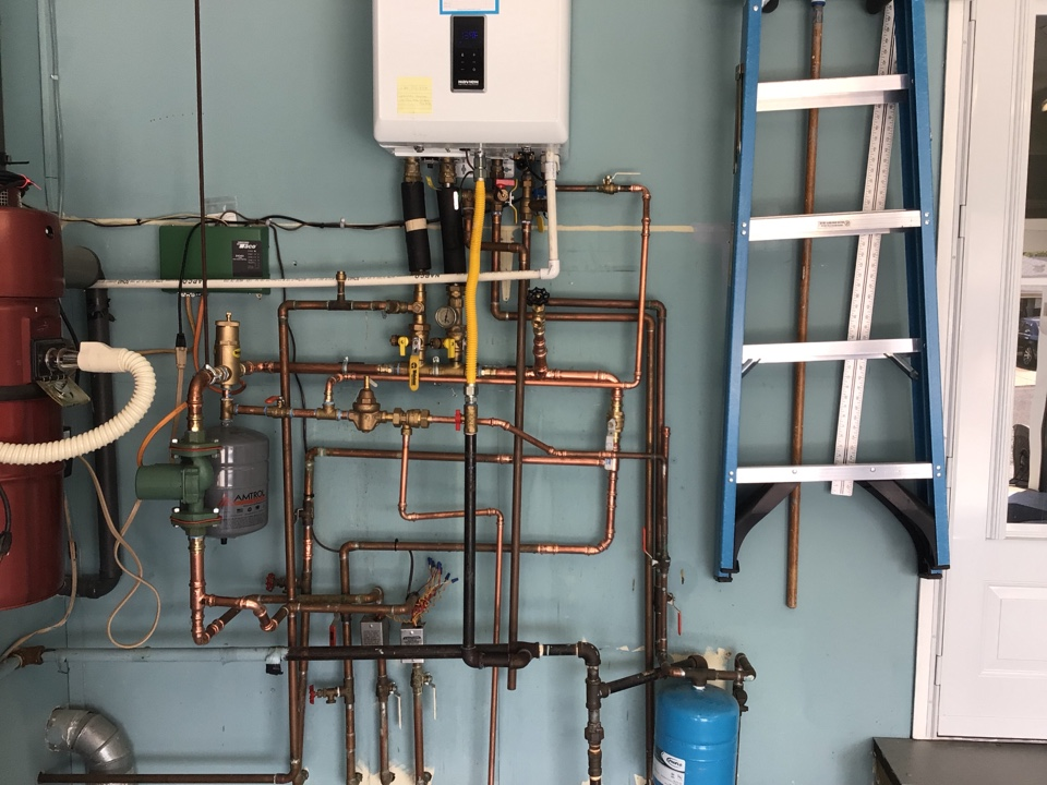 Repiped tankless combi and descaled heat and domestic side of unit in lanoka harbor