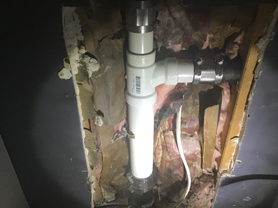 Repaired broken sewer line in house on slab, replaced washing machine valves, and installed new hose bibb in Brick NJ.