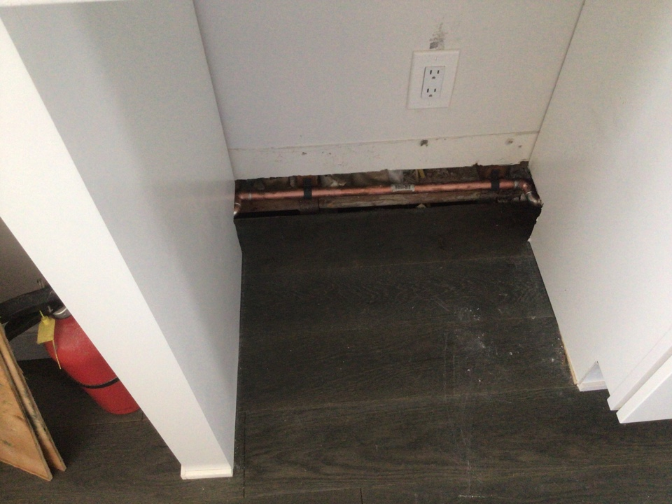 Reroute baseboard heating pipe in wall for a refergerator job is in Seaside Park