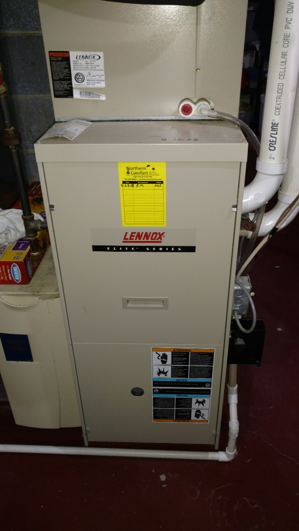 Phillips, WI - Perform preventive maintenance check on Lennox Elite LP gas furnace. Replace drain hose with PVC pipe to prevent potential blockage.