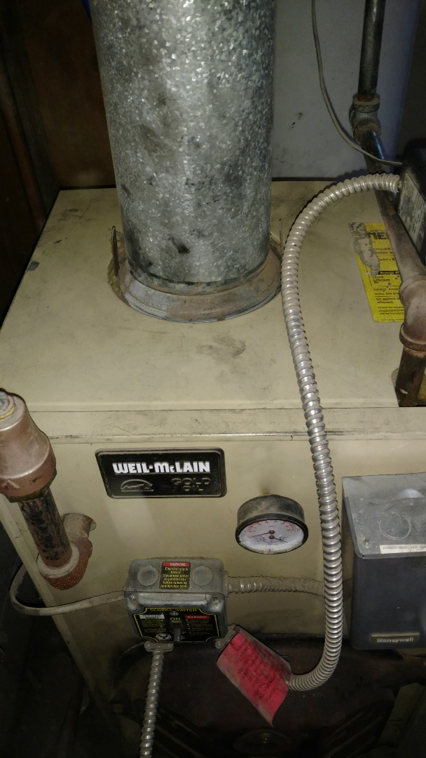 Hawkins, WI - Service Weil McLain oil boiler. Change fuel filter and nozzle.