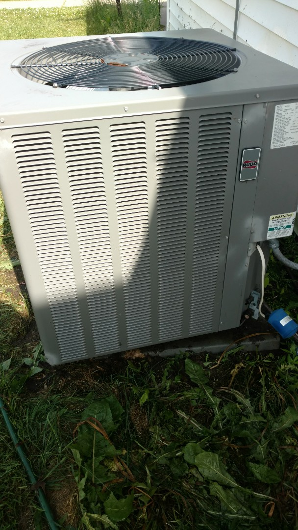 Ogema, WI - Clean coil on Ruud central air conditioner.