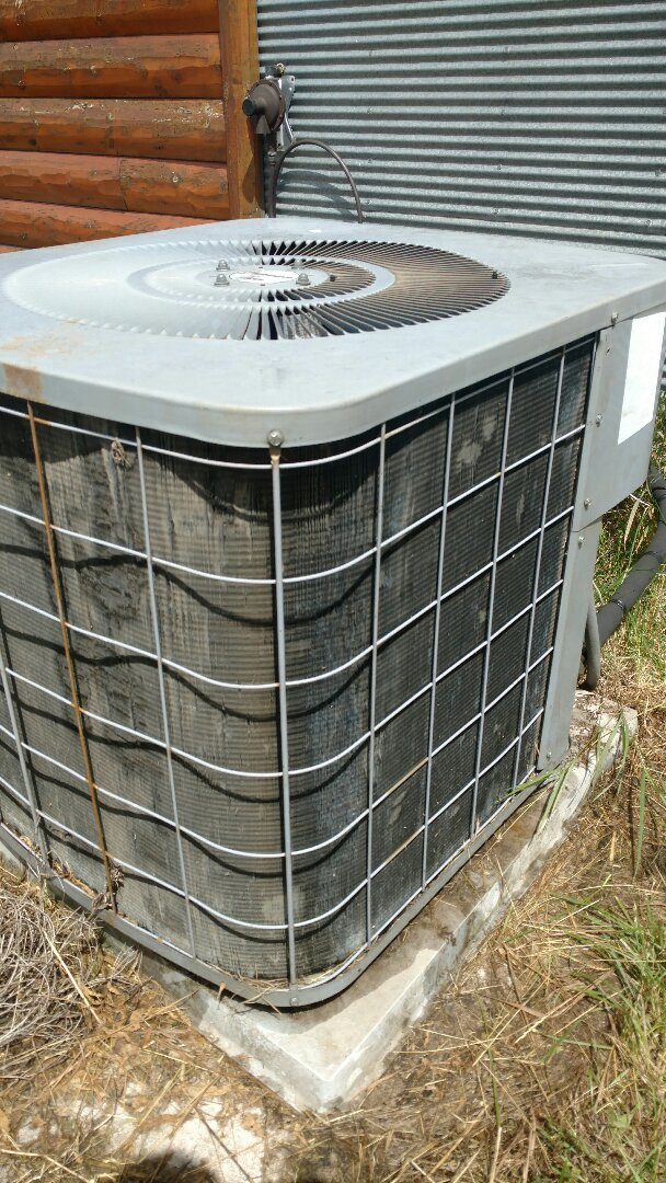 Catawba, WI - Replaced outdoor condenser fan motor and run capacitor on a Comfortmaker air conditioner.
