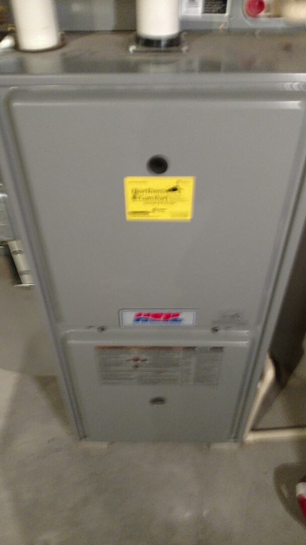 Phillips, WI - Perform maintenance on Heil furnace. Install duct booster fan