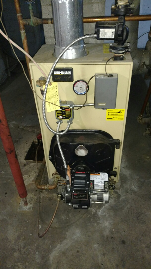 Kennan, WI - Vacuum Soot from Weil Mclain oil boiler hydronic heat system. Change nozzle and oil filter. Adjust electrodes and check controls. Inspect chimney.