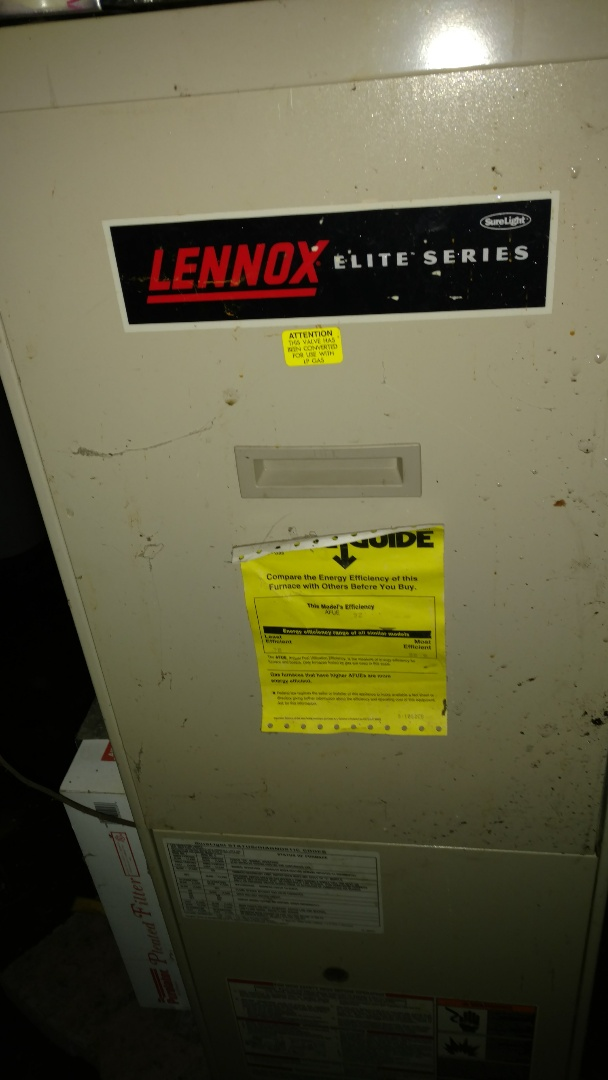 Hawkins, WI - Clean flame sensor and condensate trap on Lennox Elite Series LP gas furnace.