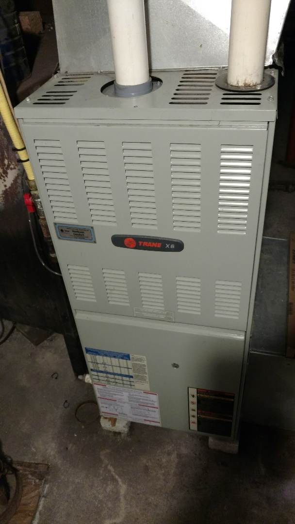 Phillips, WI - Perform preventive maintenance check on Trane XB90 furnace.  Replace deteriorated flame sensor.