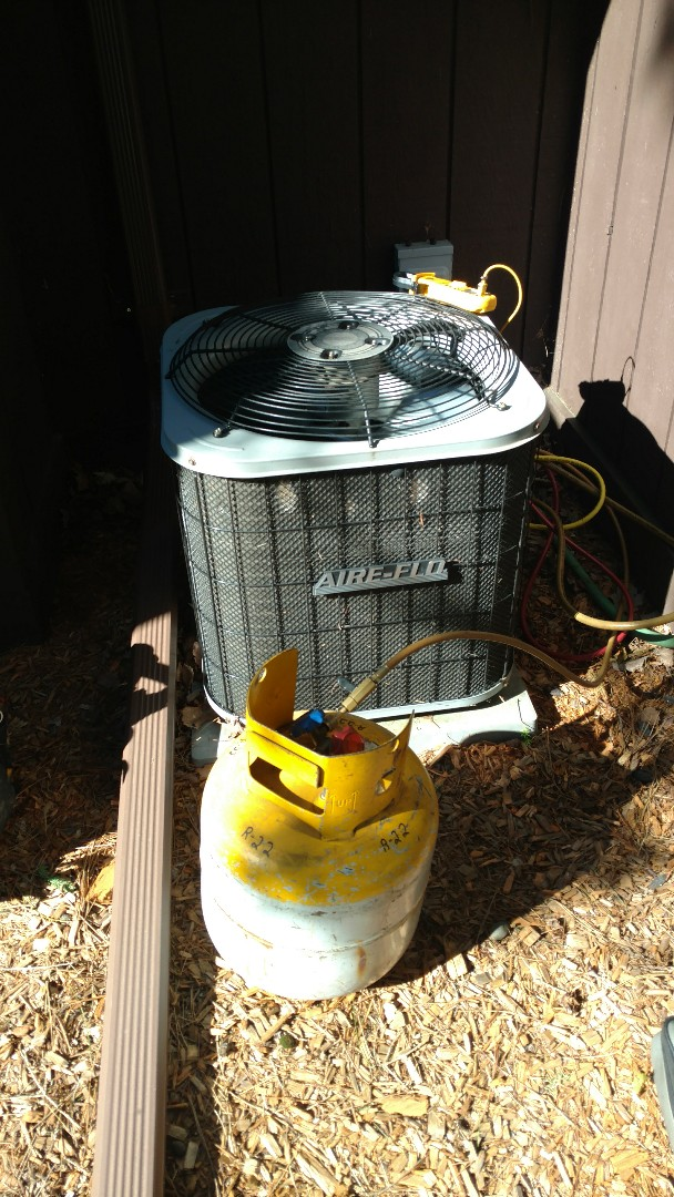 Phillips, WI - Check operation of Lennox gas furnace and Air-flo central air conditioning unit. Remove R-22 freon overcharge to attain proper operating pressures and temps.