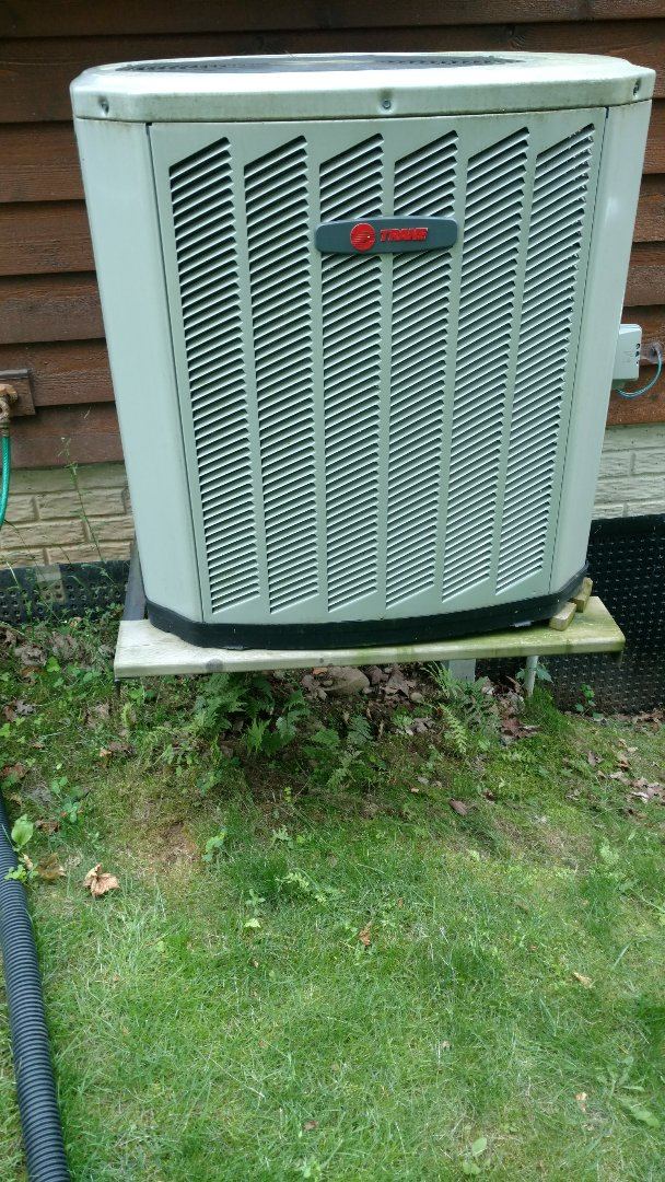 Park Falls, WI - Perform preventive maintenance check on Trane XR13 central air conditioning unit.