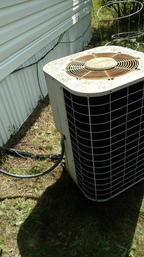 Hayward, WI - Cleaned condenser and evaporator coil on Coleman mobile home Air Conditioner. Installed customer supplied Honeywell thermostat.