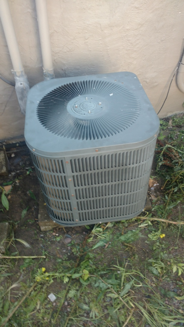 Phillips, WI - Clean dirty outdoor condenser coil. Replace leaking run capacitor on a Goodman air conditioner.
