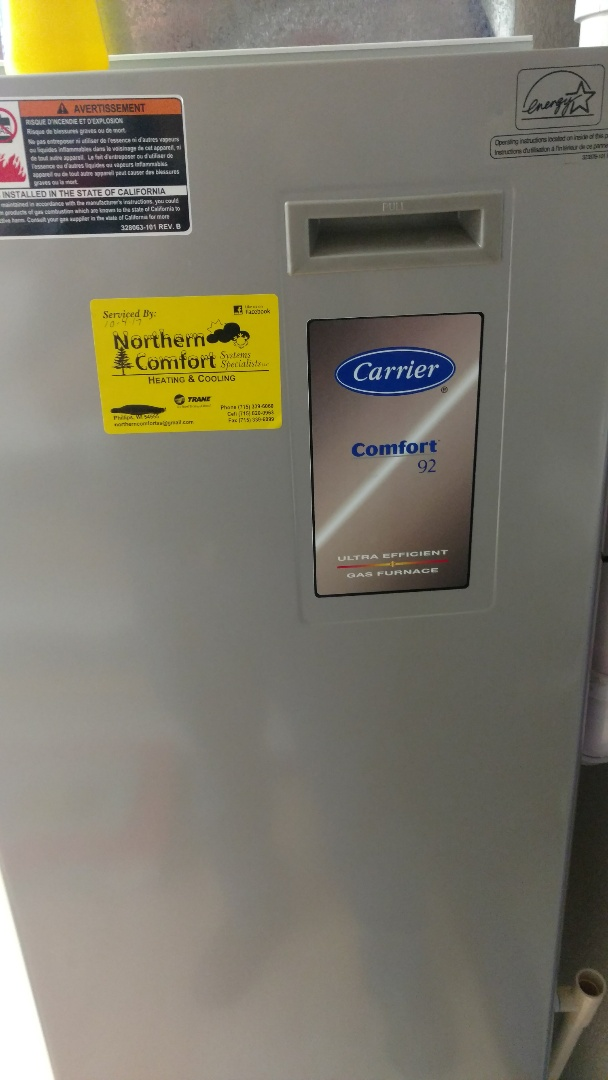 Irma, WI - Perform preventive maintenance check on Carrier 92 Plus furnace