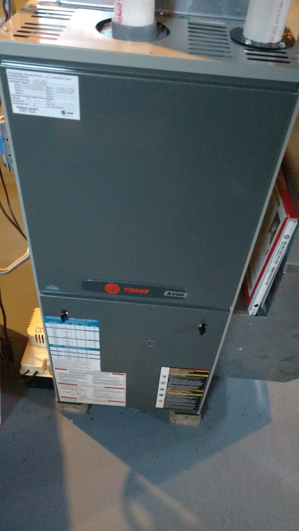 Phillips, WI - Perform fall check on Trane XV90 gas furnace. Clean flame sensor in condensate trap. Check burners in ignitor.