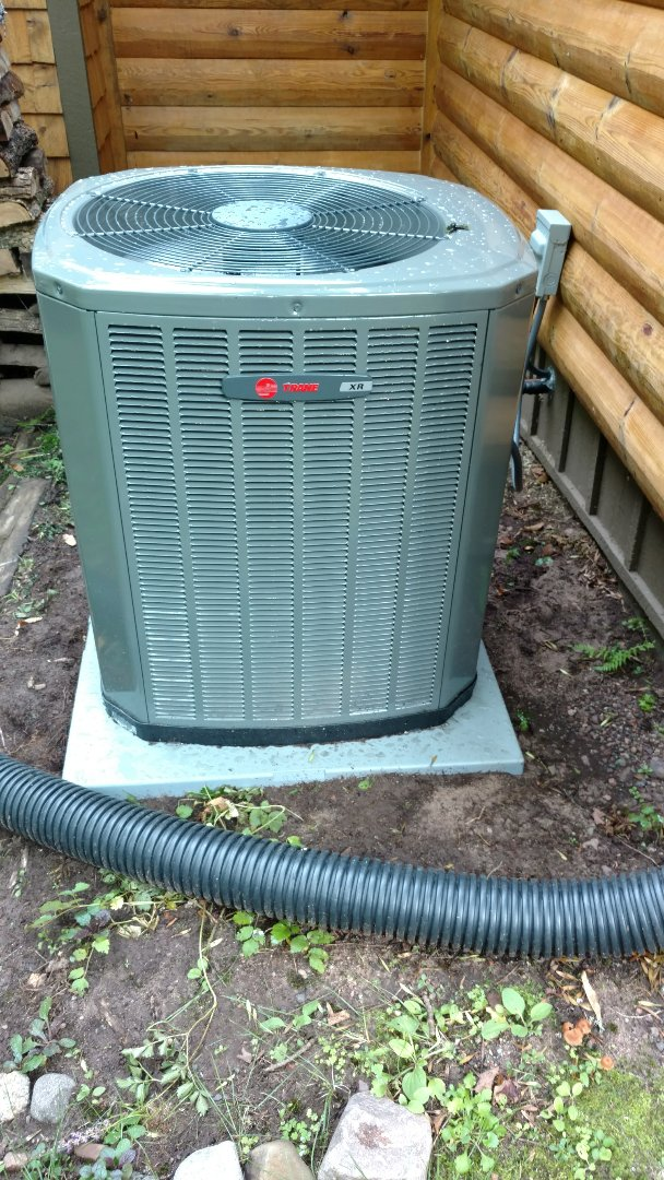 Phillips, WI - Install new Trane XR16 air conditioning unit.