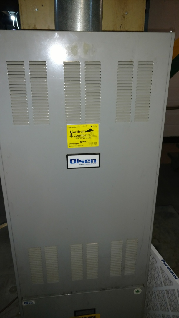 Hawkins, WI - Service Duo Matic Olsen oil furnace. Vacuum soot from heat exchanger. Change nozzle and oil filter.