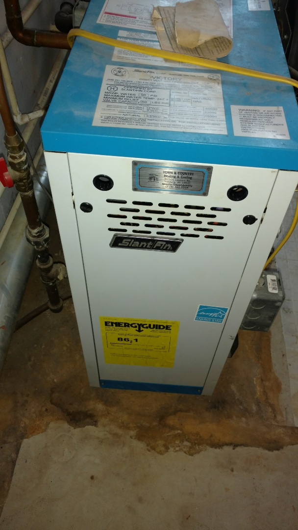 Glen Flora, WI - Perform preventive maintenance check on Slant Fin LP gas boiler. Adjust tank pressure to 12 PSI