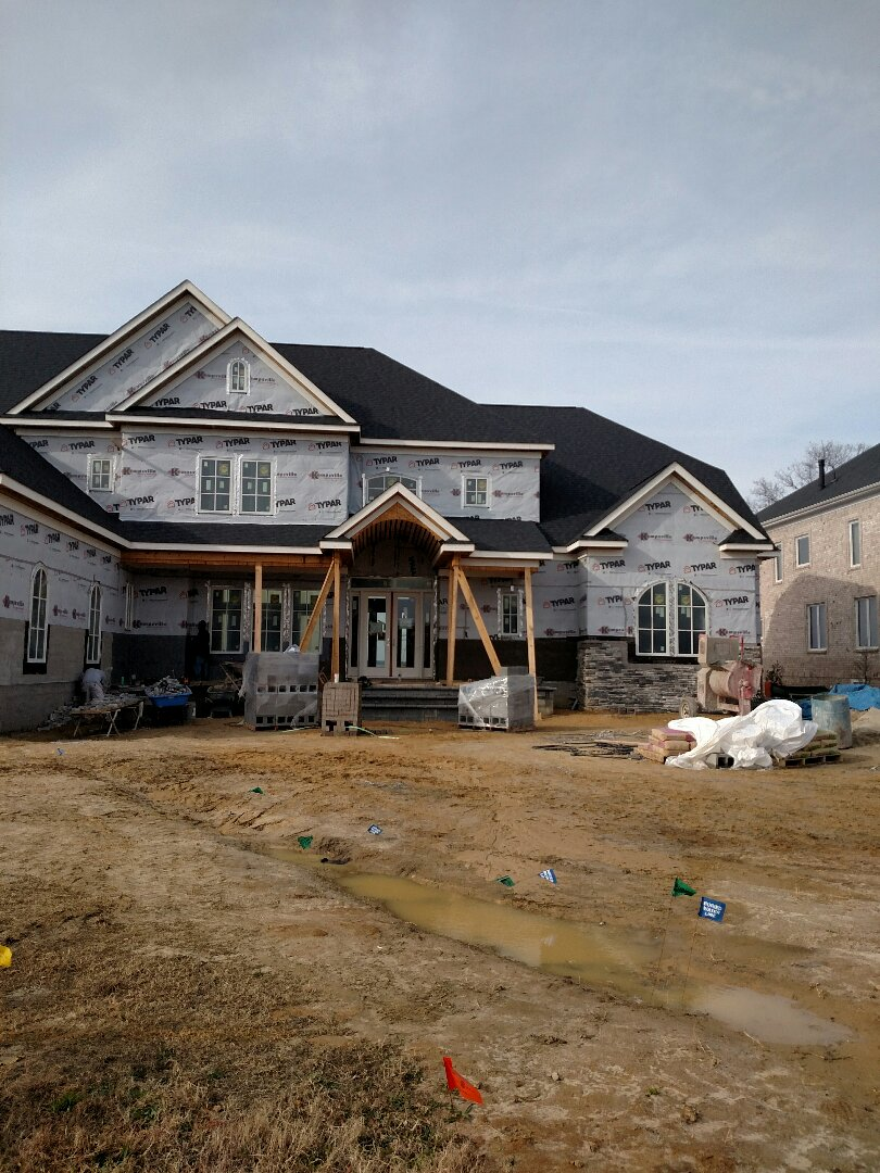 Suffolk, VA - Custom new construction home having stone installed on front elevation