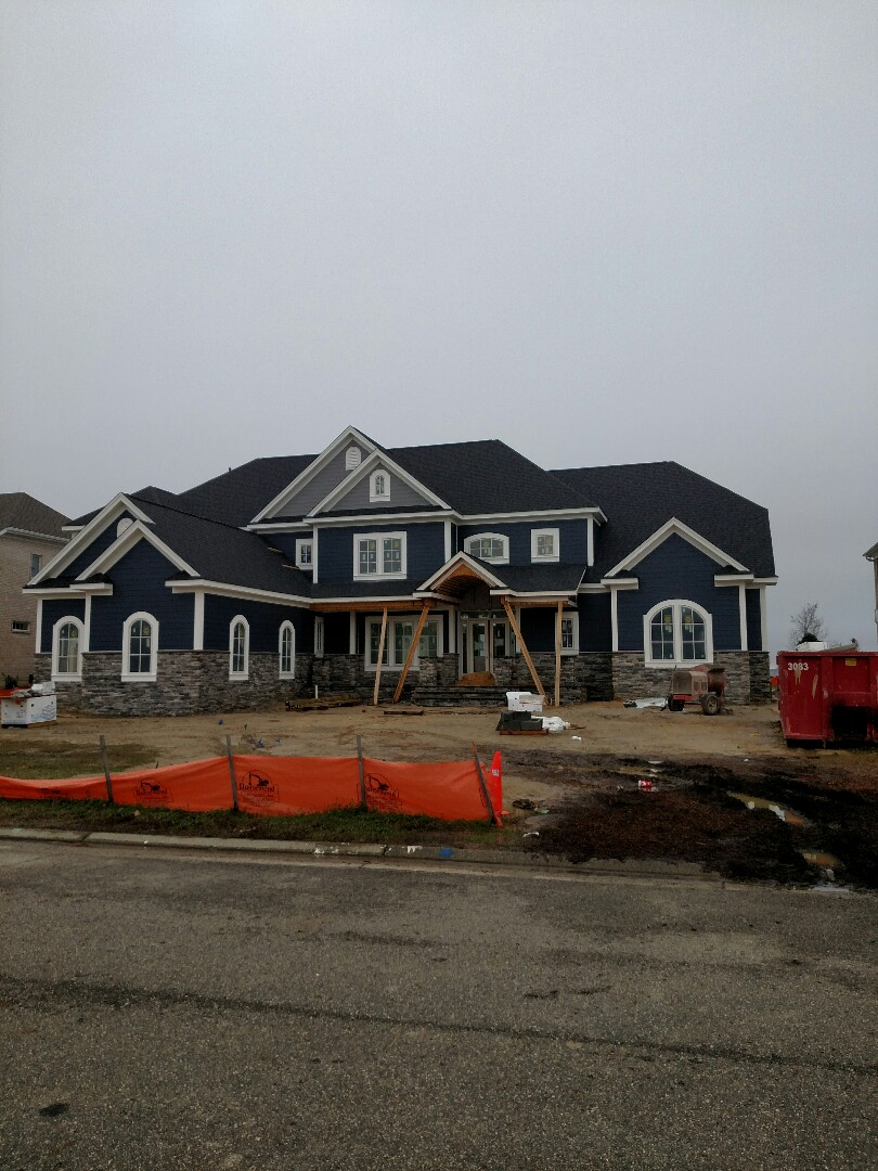 Suffolk, VA - New construction custom home on the water.  Stone and siding finished.  Porch is next.
