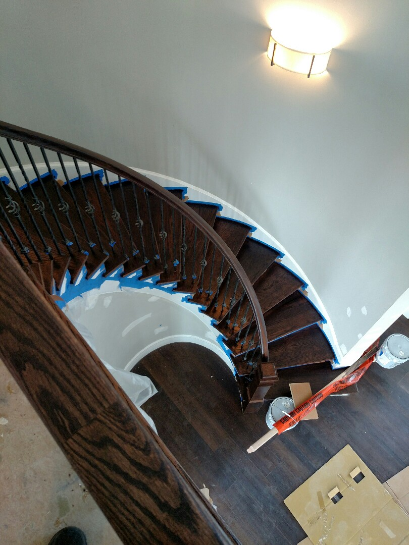Suffolk, VA - Custom home curved stairway is stained
