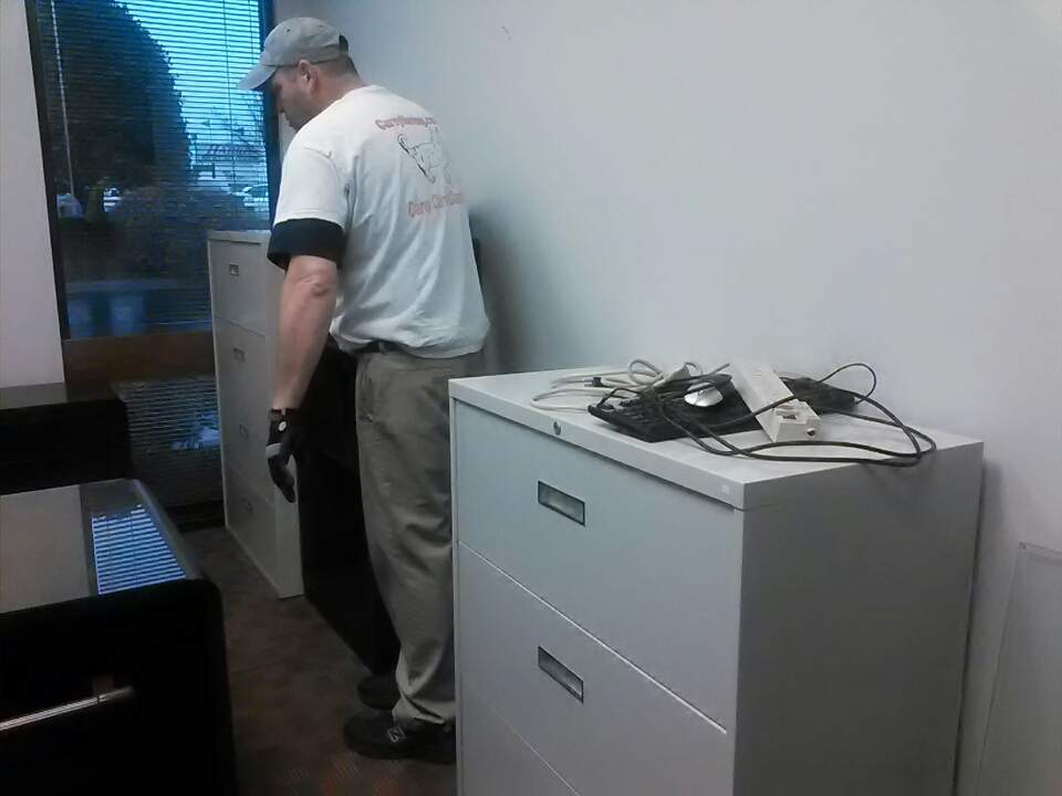 Seneca, SC -  Moving office furniture around inside a Professional office building.