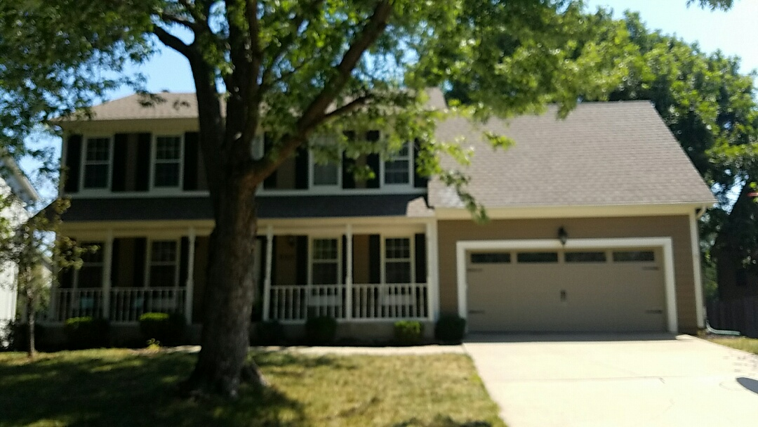 Overland Park, KS - Estimating new replacement windows, fiber cement siding and deck in Overland Park for Andrew and Mandy M.
