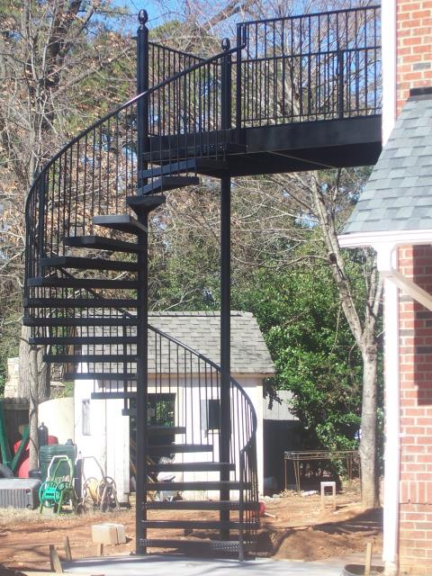 Cary, NC - We custom design, build and install beautiful wrought iron spiral staircases Give us a call for a free estimate!