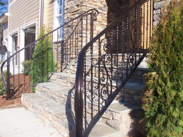 Wake Forest, NC - Our custom crafted wrought iron railings add an elegant yet inviting element to the entrance of your home.  We never sacrifice on quality and always powder coated for long-term low maintenance!