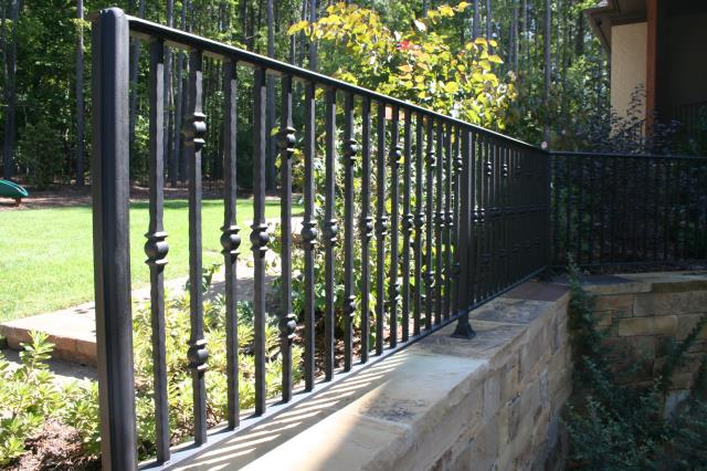 Cary, NC - We custom build elegant iron railings for retaining walls, patios and porches!  We install throughout Cary including Lochmere, Preston, Highcroft, MacGregor, Cary Parkway and more!