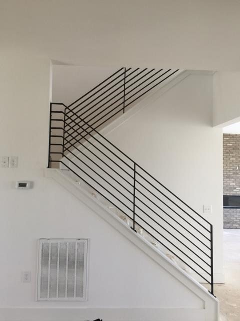 Chapel Hill, NC - Clean, crisp horizontal steel or iron railings are the latest trend.  Give us a call to find out about upgrading your existing interior or exterior railings!