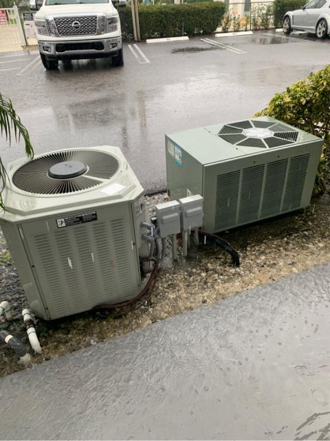 Tequesta, FL - This customer decided to trade-in her old Rheem air-conditioning system for a new Arnold's Air Conditioning Private Label manufactured by Goodman. The old Rheem (on the right) will be replaced over the next week along with the air handler and thermostat inside. We will keep you posted.