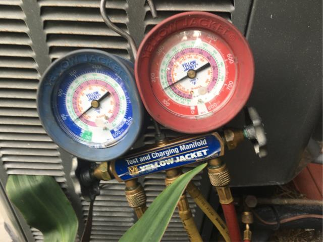 Vero Beach, FL - Air conditioning system not cooling; added refrigerant and system cooling again.