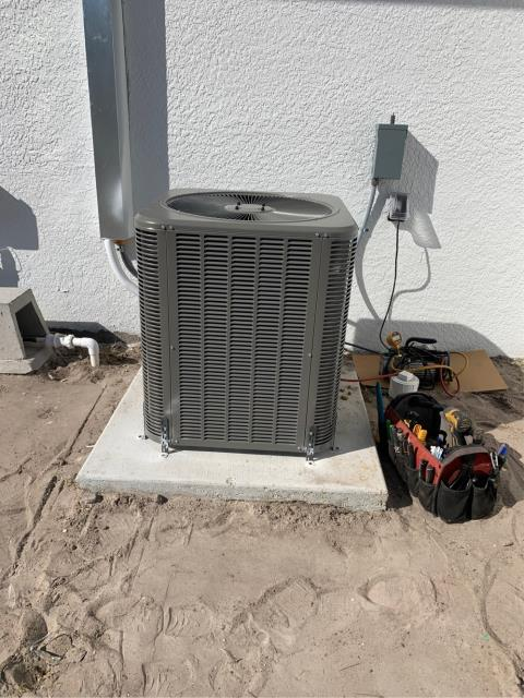 Palm City, FL - Air conditioning system installation and start up of condenser for new construction.