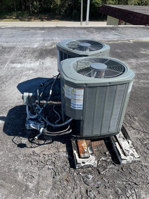LAKE CLARKE, FL - Air conditioning systems need to be on stands; provided customer an estimate to install stands under the ac condensers.