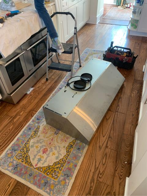 Jensen Beach, FL - Installation of range hood; penetrated exterior wall and installed ductwork and capped with bird screen and backdraft damper.