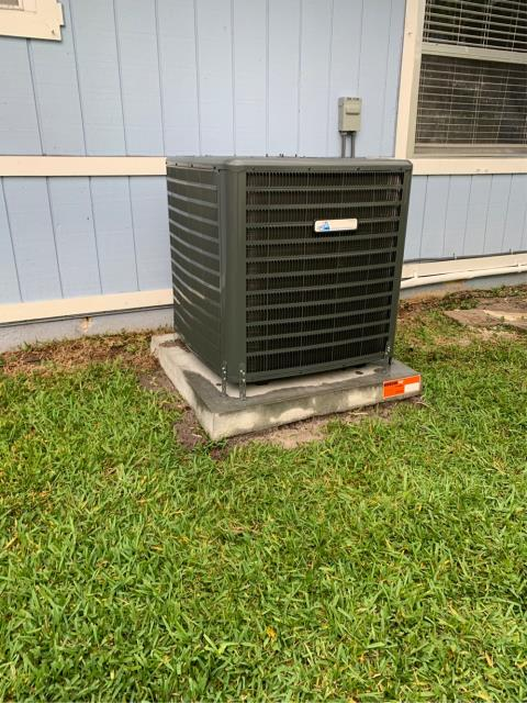 Port Salerno, FL - Air conditioning system installation of a 3.5 ton, 16.00 SEER, single speed condenser fan motor, multi speed electronically commuted blower; included is a 10 year parts and labor warranty.