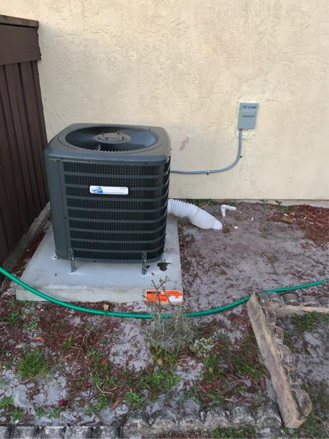 Port St. Lucie, FL - Air conditioning system installation of a 2 ton, 14.0 SEER, single state compressor.  This system comes with a 10 year parts warranty.