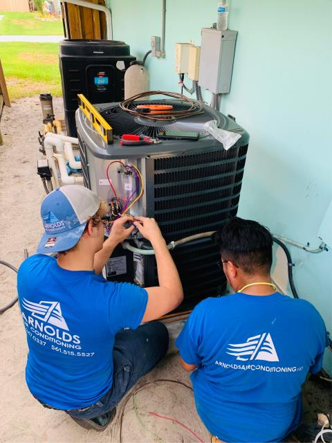Palm City, FL - Air conditioning system installation of a 3.0 Ton, 14 SEER, single stage compressor and condenser fan motor with digital thermostat.  This unit comes with a 10 year parts warranty.