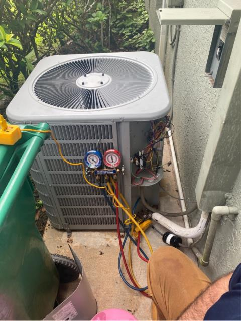 Port St. Lucie, FL - Air conditioning system not cooling; found system low on refrigerant causing capacitor to overheat and blow.   Also, found drain line clogged.  Replaced capacitor, charged system with refrigerant and flushed drain line.