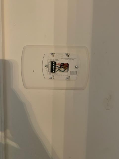 Riviera Beach, FL - Air conditioning system service call to mount thermostat back on wall and change batteries.