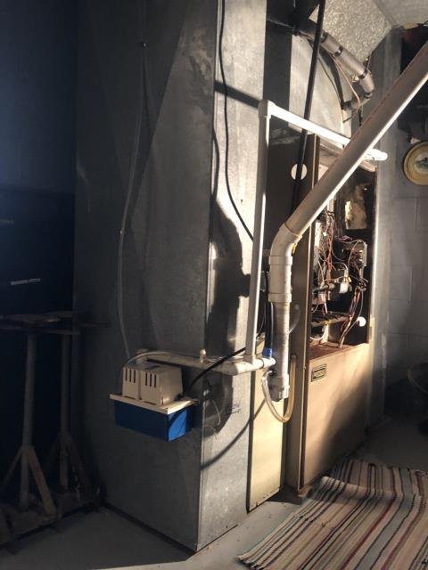 Pataskala, OH - Water around 1987 Ultra 2 furnace area.Customer did replace PVC drain line, which maybe solved some issues. Condensate pump is working correctly.Inducer motor is over amping and making a loud noise- inducer motor soon to fail. Furnace internally is rusted out.