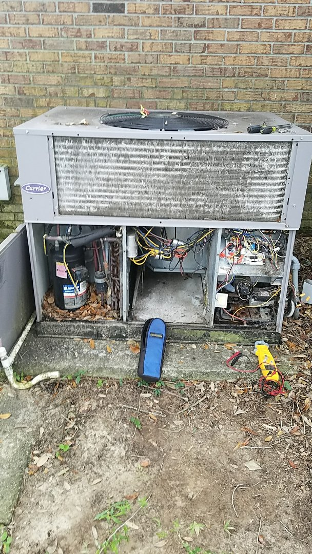 Charleston, SC - Carrier 2.5 ton gas pack furnace repair. Found 1 of 2 burners rusted and broken and heat exchanger cracked allowing carbon monoxide in conditioned air. Disabled unit and will quote for furnace installation.